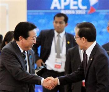 笑顔で握手-野田 APECにて.jpg